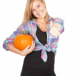 Girl with orange pumpkin — Stock Photo #7254617