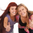 Female friends with thumbs up — Stock Photo