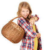 Pointing you girl with wicker basket — Stock Photo