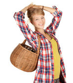 Girl with wicker basket — Stock Photo