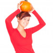 Orange pumpkin with girl — Stock Photo