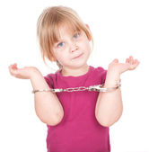 Handcuffs and liitle girl — Stock Photo