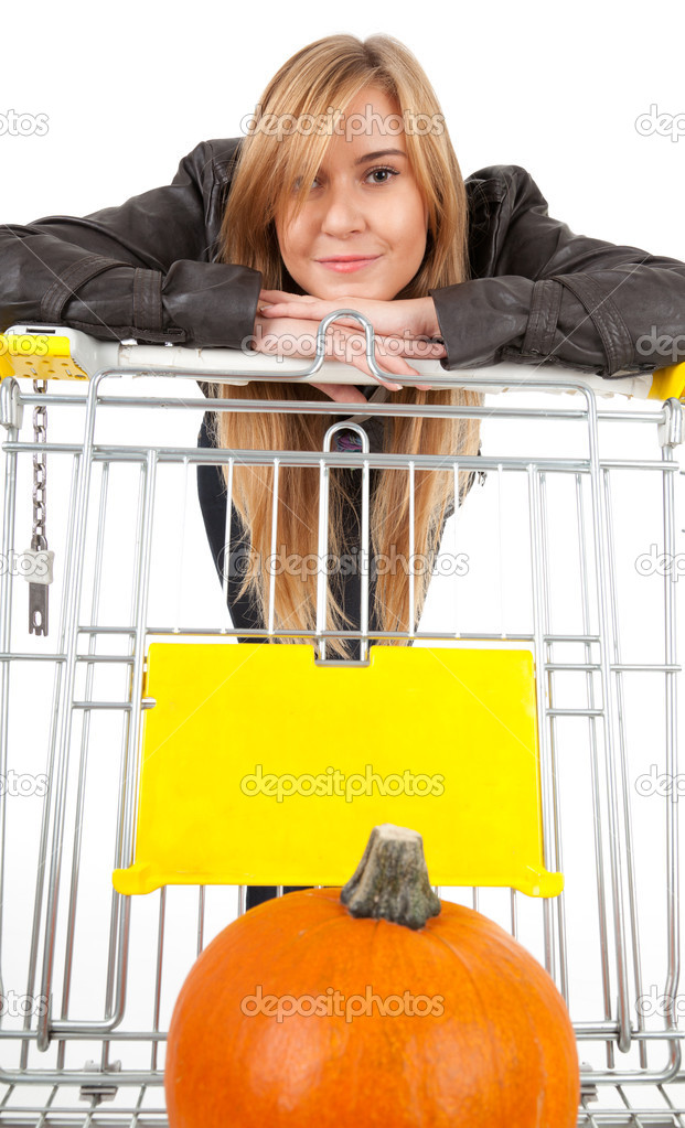 Young beautiful woman with shopping cart, white background — Stock Photo #7282085