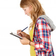 Student girl writing on clipboard — Foto de Stock