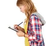 fille étudiante d'écriture sur le presse-papiers — Photo