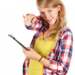 Pointing girl with clipboard — Stock Photo