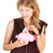 Girl putting five euro in piggy bank — Stock Photo