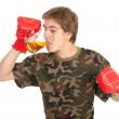 Man in boxing gloves with beer — Stock Photo