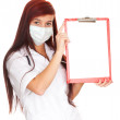 Lady doctor with clipboard — Stock Photo