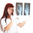 Female doctor looking at x-ray — Stock Photo #7326318