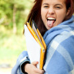 Crazy student girl in blanket — Stock Photo