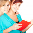 Stock Photo: Female friends reading book