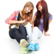 Female friends with cat — Stock Photo