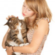 Teenage girl with her cat - Stock Photo