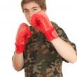 Royalty-Free Stock Photo: Young man in boxing gloves