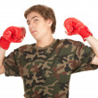 Foto de Stock  : Young man in boxing gloves