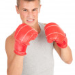 Young man in boxing gloves — Stock Photo
