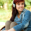 Girl wearing headphones — Stock Photo
