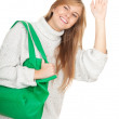 Girl with green shopping bag — Stock Photo #7326697