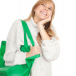 Girl with green shopping bag — Stock Photo