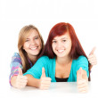 Foto de Stock  : Female friends with thumbs up