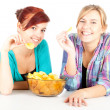 Teenage female friends and chips — ストック写真
