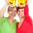 Girls friends with beer — Stock Photo