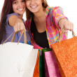 Stock Photo: Girls with shopping bags