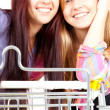 Shopping cart and girls — Photo