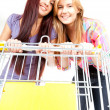 Shopping cart and girls — Stock Photo