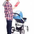 Baby stroller and reading mother — Stock Photo
