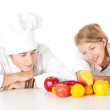 Cooks team with fruits and vegetables — Stock Photo