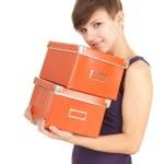 Girl with orange boxes — Stock Photo