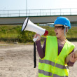 Female engineer megaphone and blueprint — Stock Photo