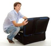 Joven casual con maleta — Foto de Stock