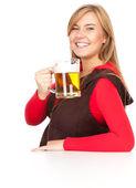 Girl with the mug of beer — Stock Photo