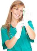 Nurse getting syringe ready to injection — Stock Photo