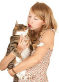 Teenage girl with her cat — Stockfoto