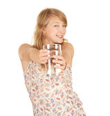 Glass of water and attractive girl — Stock Photo