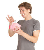 Piggy bank and teenage boy — Stock Photo
