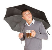 Young man with black umbrella — Stock Photo
