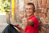 Male student with laptop — Stock Photo