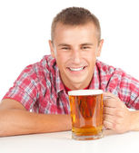 Smiling young man with beer — Stock Photo
