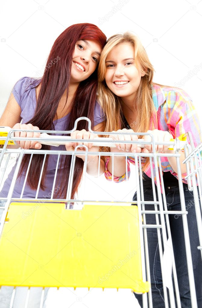 Young beautiful women with shopping cart white background  Stock Photo #7326769