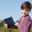 Girl using laptop — Stock Photo