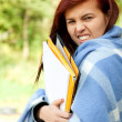 Student girl  wrapped in blanket — Stock Photo