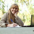 Female student using  laptop — Stock Photo