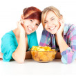 Teenage female friends and chips — Stock Photo #7340620