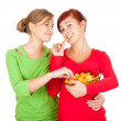 Teenage female friends and chips — Stock Photo