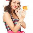 Santa girl in red Christmas hat — Stock Photo #7342256